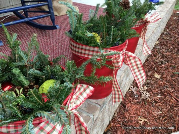 s make your porch look amazing with these diy christmas ideas, christmas decorations, Stick tree branches and pine cones in buckets