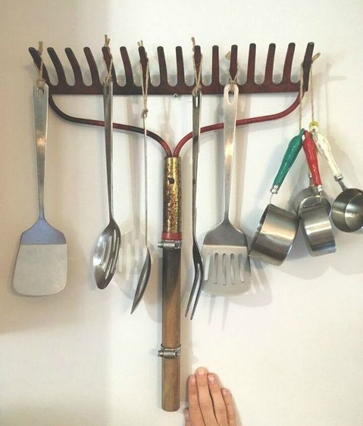 s 13 storage ideas that will instantly declutter your kitchen drawers, kitchen design, organizing, storage ideas, Repurpose an old rake for your baking goods