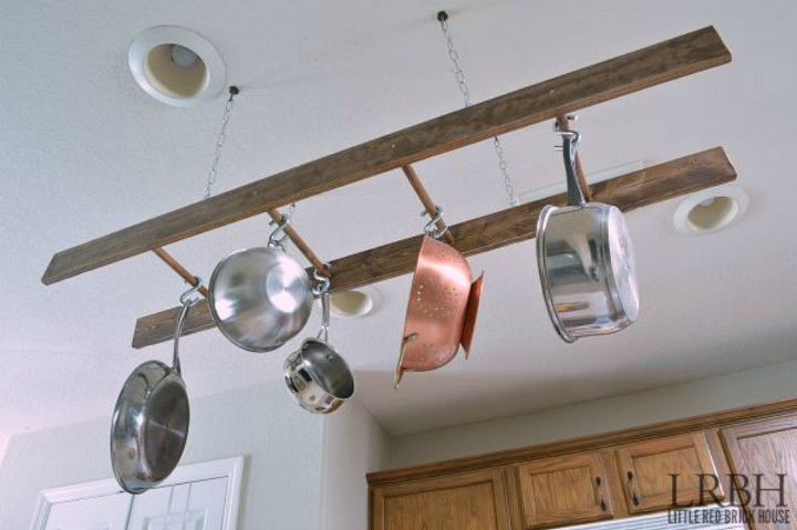 s 13 storage ideas that will instantly declutter your kitchen drawers, kitchen design, organizing, storage ideas, Use a ladder to hang your pots and pans