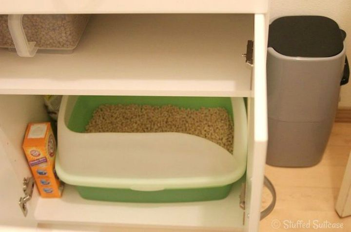 s cat owners 12 ways to hide a litter box in plain site, Cut a hole in a Home Depot cabinet