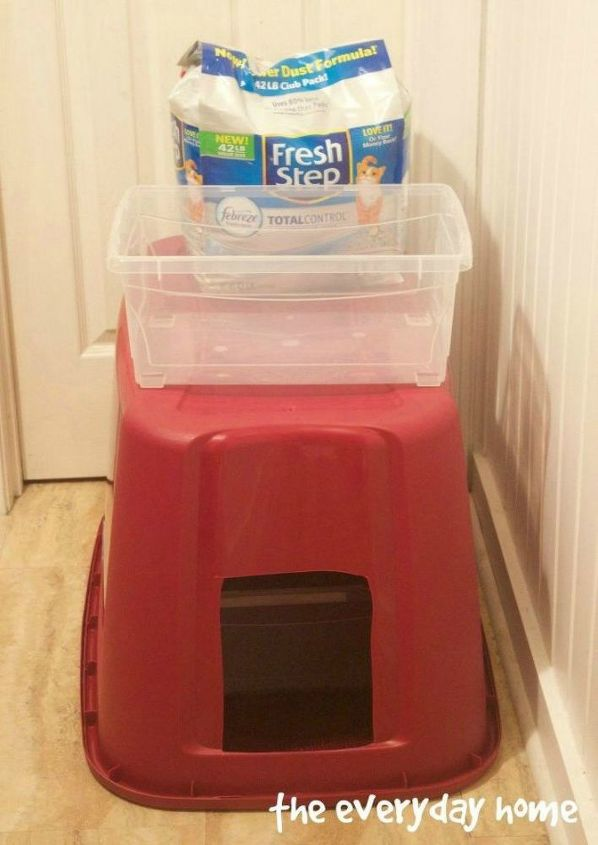 s cat owners 12 ways to hide a litter box in plain site, Flip a bin and cut a cat door on the side
