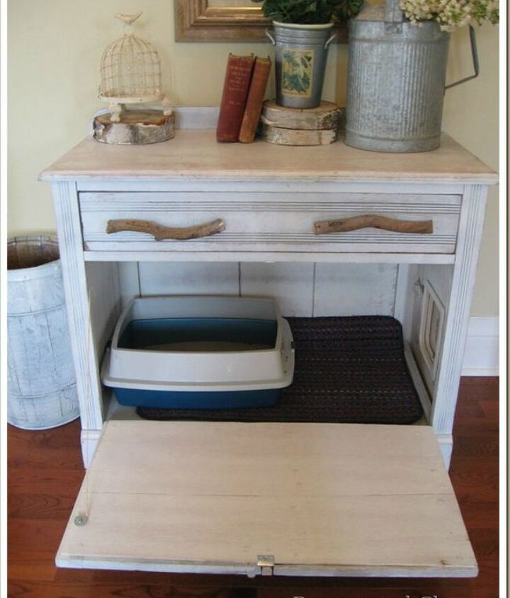 s cat owners 12 ways to hide a litter box in plain site, Gut an old cabinet to give your kitty privacy