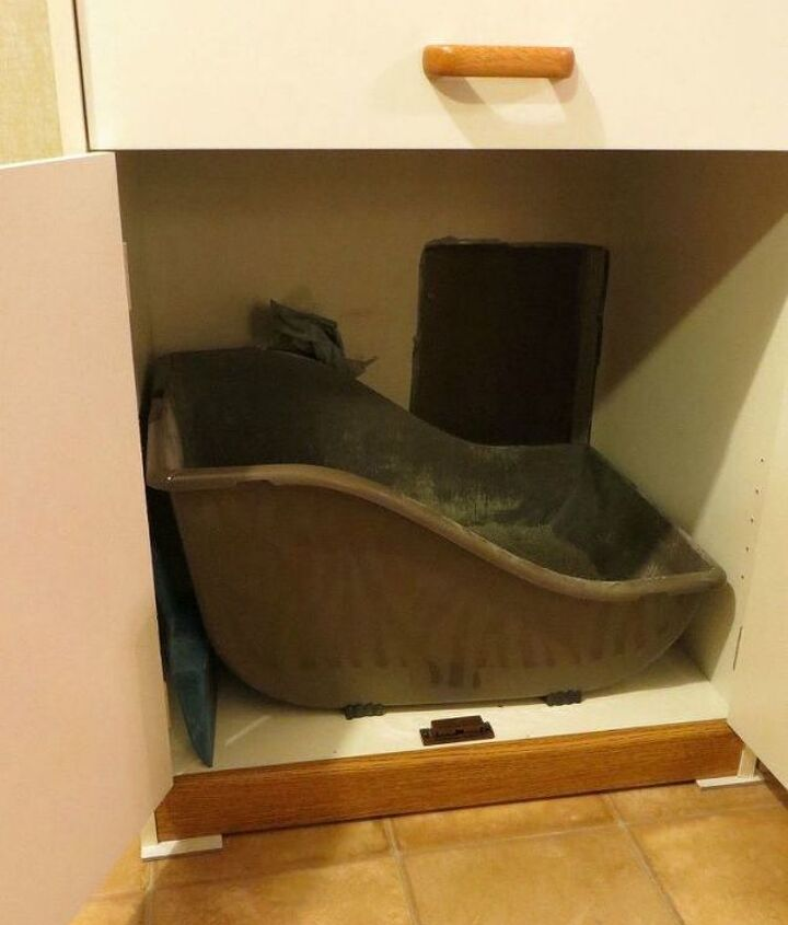 s cat owners 12 ways to hide a litter box in plain site, Remove the back of a microwave stand