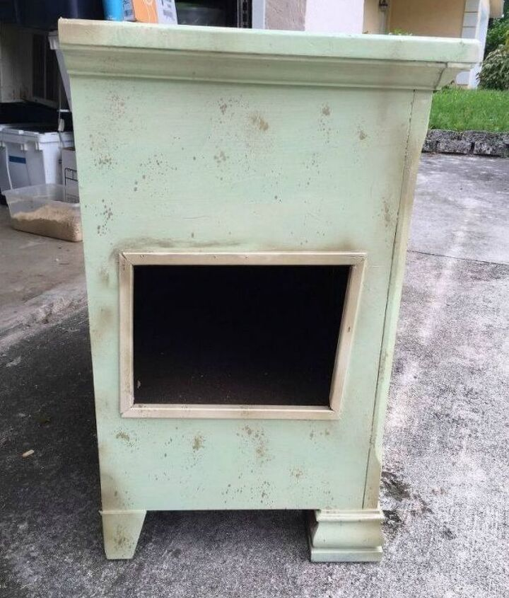 s cat owners 12 ways to hide a litter box in plain site, Revamp a bedside table and add a kitty door