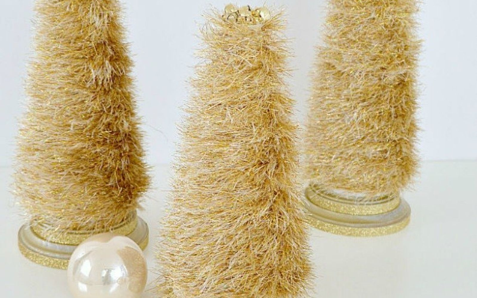 s cut up styrofoam for these breathtaking christmas ideas, christmas decorations, Or with frilly gold yarn