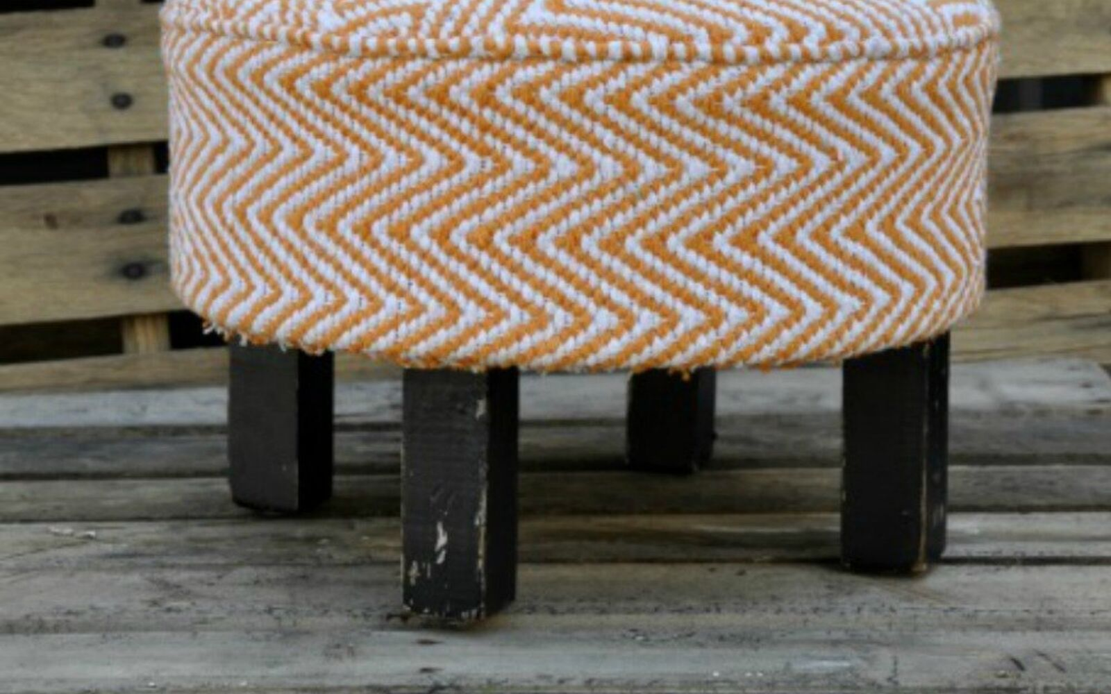s transform dollar store rugs with these 11 stunning ideas, reupholster, Use a rug to give new life to an old ottoman