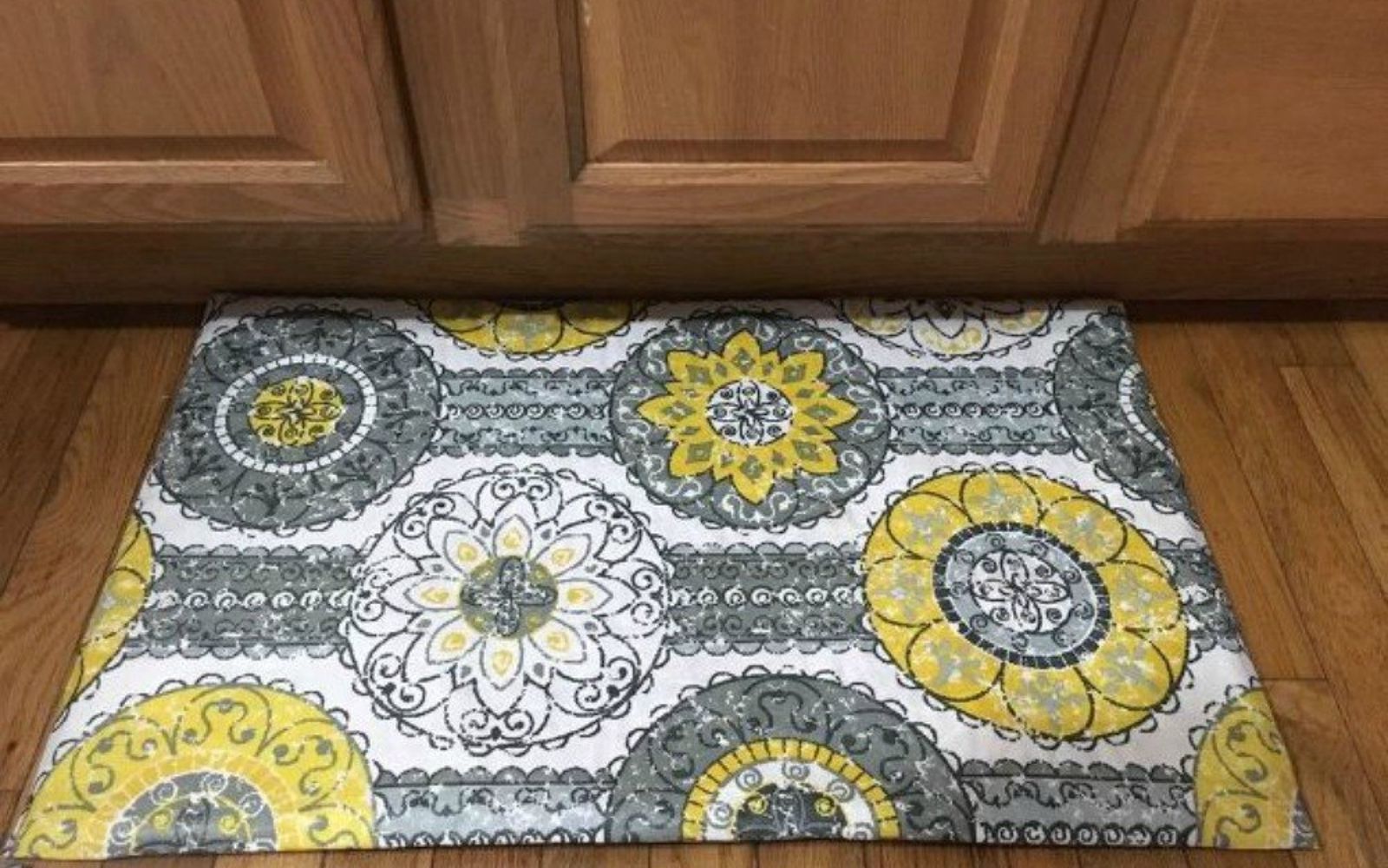 s transform dollar store rugs with these 11 stunning ideas, reupholster, Turn ugly rugs into durable kitchen mats