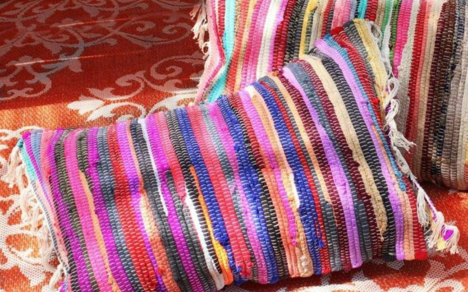 s transform dollar store rugs with these 11 stunning ideas, reupholster, Glue them to copy this lovely patio pillow