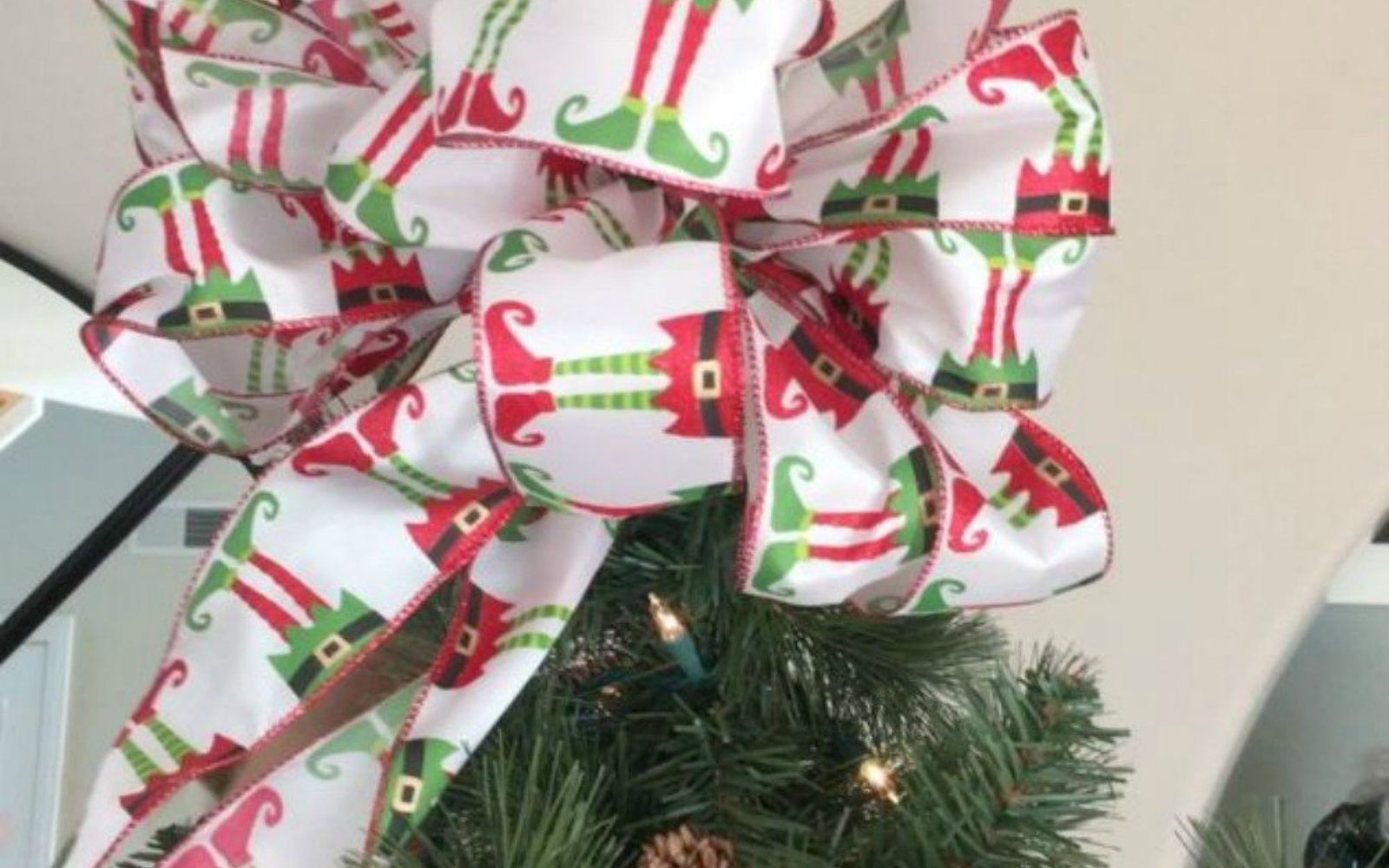 s don t stop at ornaments these tree decorating ideas are even better, christmas decorations, seasonal holiday decor, Tie a stunning bow out of ribbon