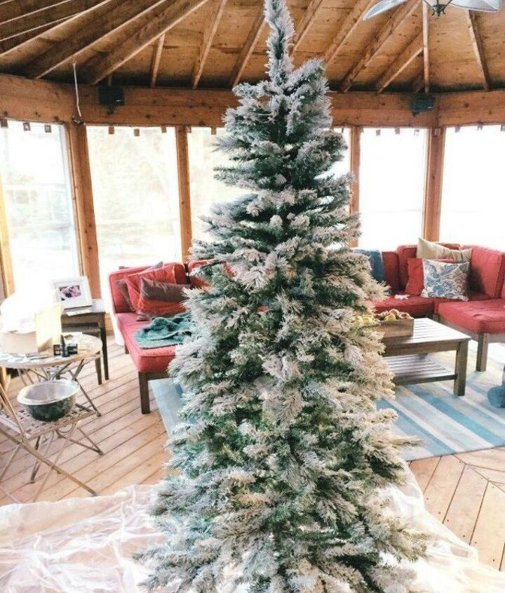s don t stop at ornaments these tree decorating ideas are even better, christmas decorations, seasonal holiday decor, Flock your tree with fake snow