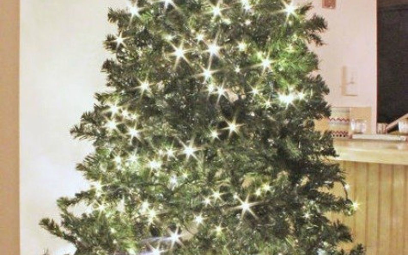 s don t stop at ornaments these tree decorating ideas are even better, christmas decorations, seasonal holiday decor, Twist twinkle lights throughout the branches