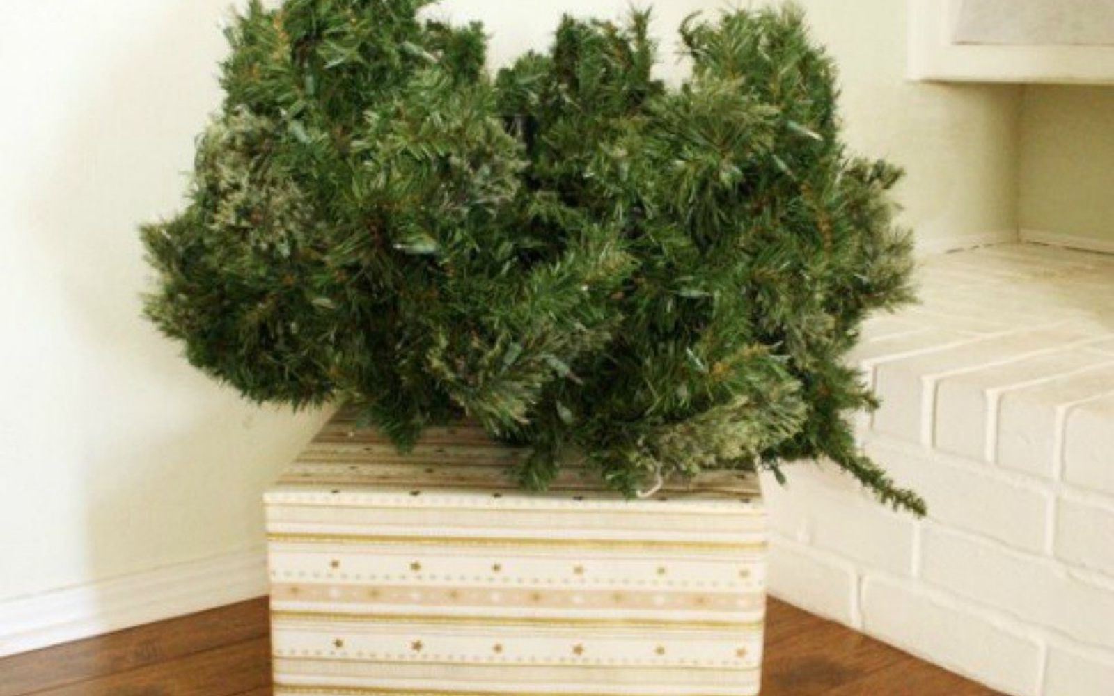 s don t stop at ornaments these tree decorating ideas are even better, christmas decorations, seasonal holiday decor, Place a cardboard box around the base