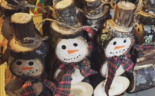 snowmen made from logs