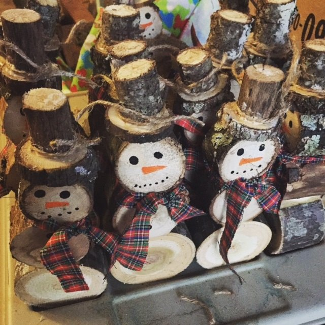 snowmen made from logs
