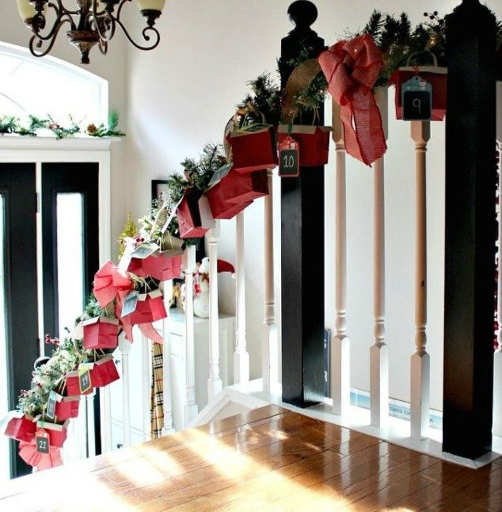 s 25 advent calendar ideas that are so cute, This stairwell garland one with mini boxes