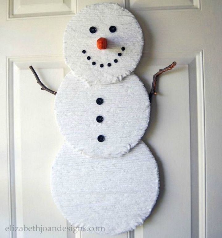 s 13 surprising ways to make a snowman for your porch, Glue white yarn on circular boards