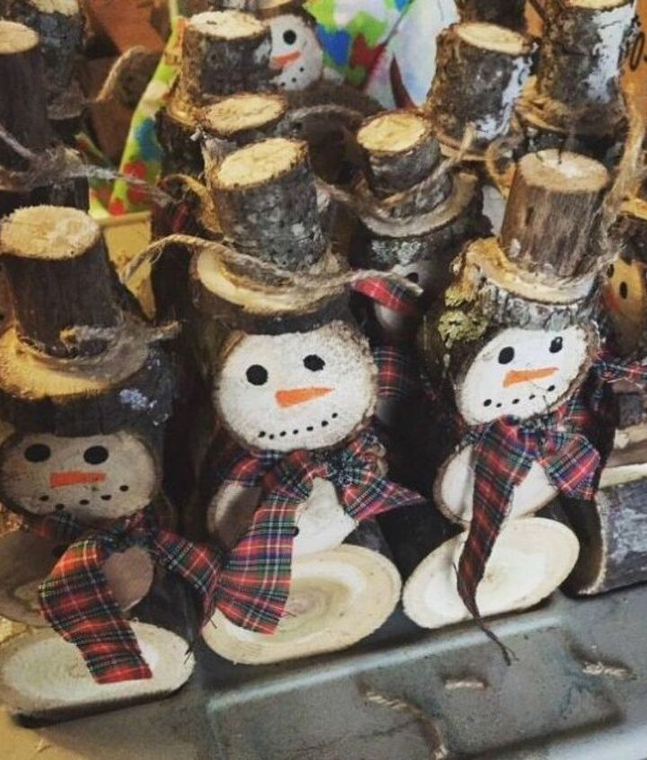 s 13 surprising ways to make a snowman for your porch, Cut some spare logs and draw on them