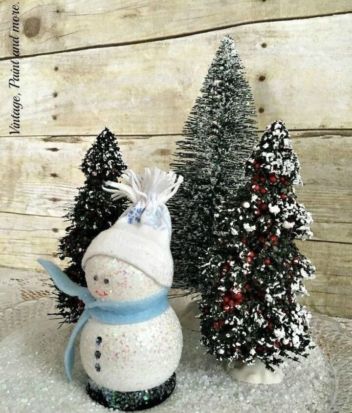 s 13 surprising ways to make a snowman for your porch, Sprinkle some glitter on wooden lathes