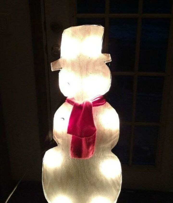 s 13 surprising ways to make a snowman for your porch, Carve some wood and add aluminium flashing