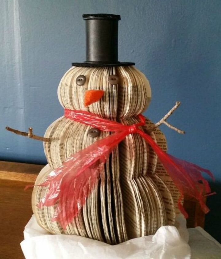 s 13 surprising ways to make a snowman for your porch, Cut up an old book