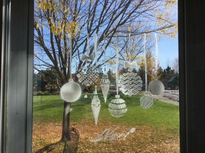 s let it snow with these 12 winter decorating ideas, Spray stencils on your window with fake snow