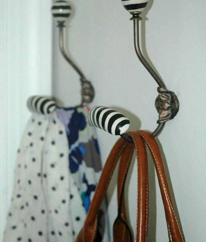 s 13 clever ways to hang up your jackets, Paint hooks with stripes for an anthro look