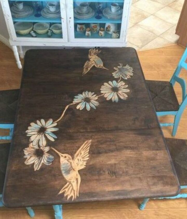 s 9 dining room table makeovers we can t stop looking at, painted furniture, After A stained wood piece of art