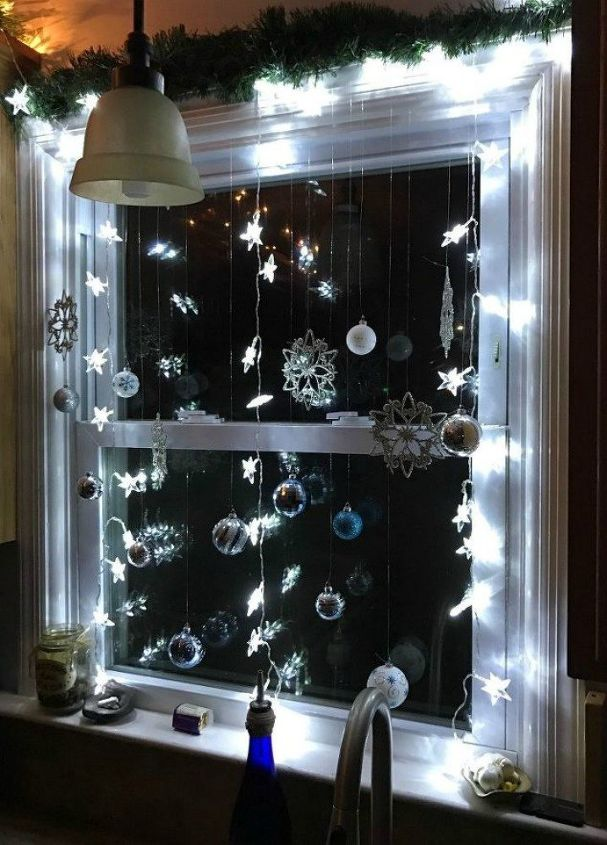 s get your kitchen ready for christmas 11 ideas , kitchen design, Hang a winter wonderland on your windowsill