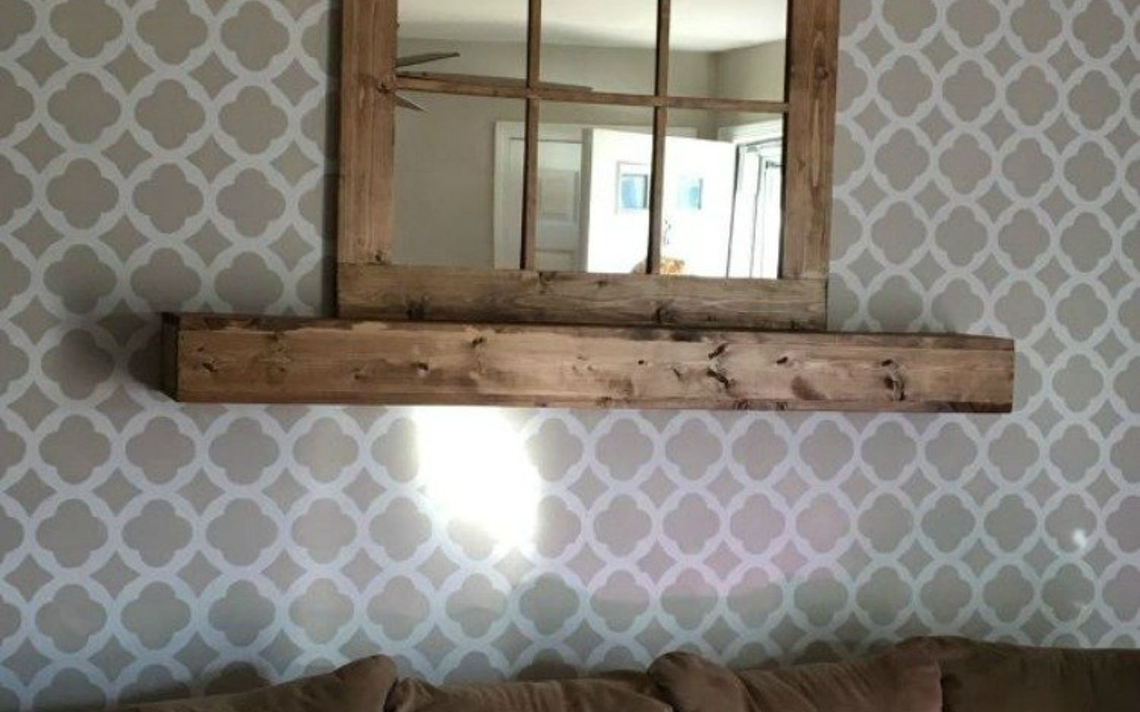 s 13 low budget ways to decorate your living room walls, go green, plumbing, Build a mantel and floating shelf