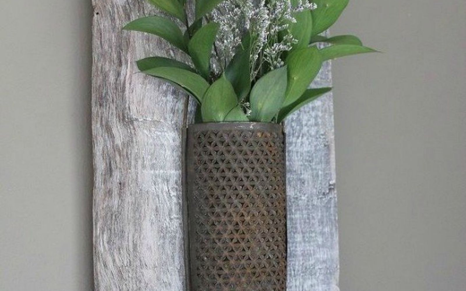 s 13 low budget ways to decorate your living room walls, go green, plumbing, Add some rustic plant wall decor