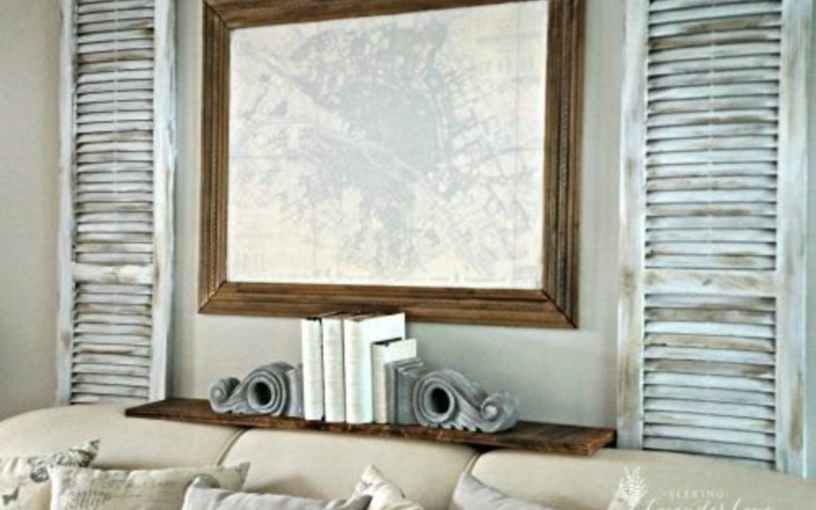 s 13 low budget ways to decorate your living room walls, go green, plumbing, Add some rustic shutters and a shelf