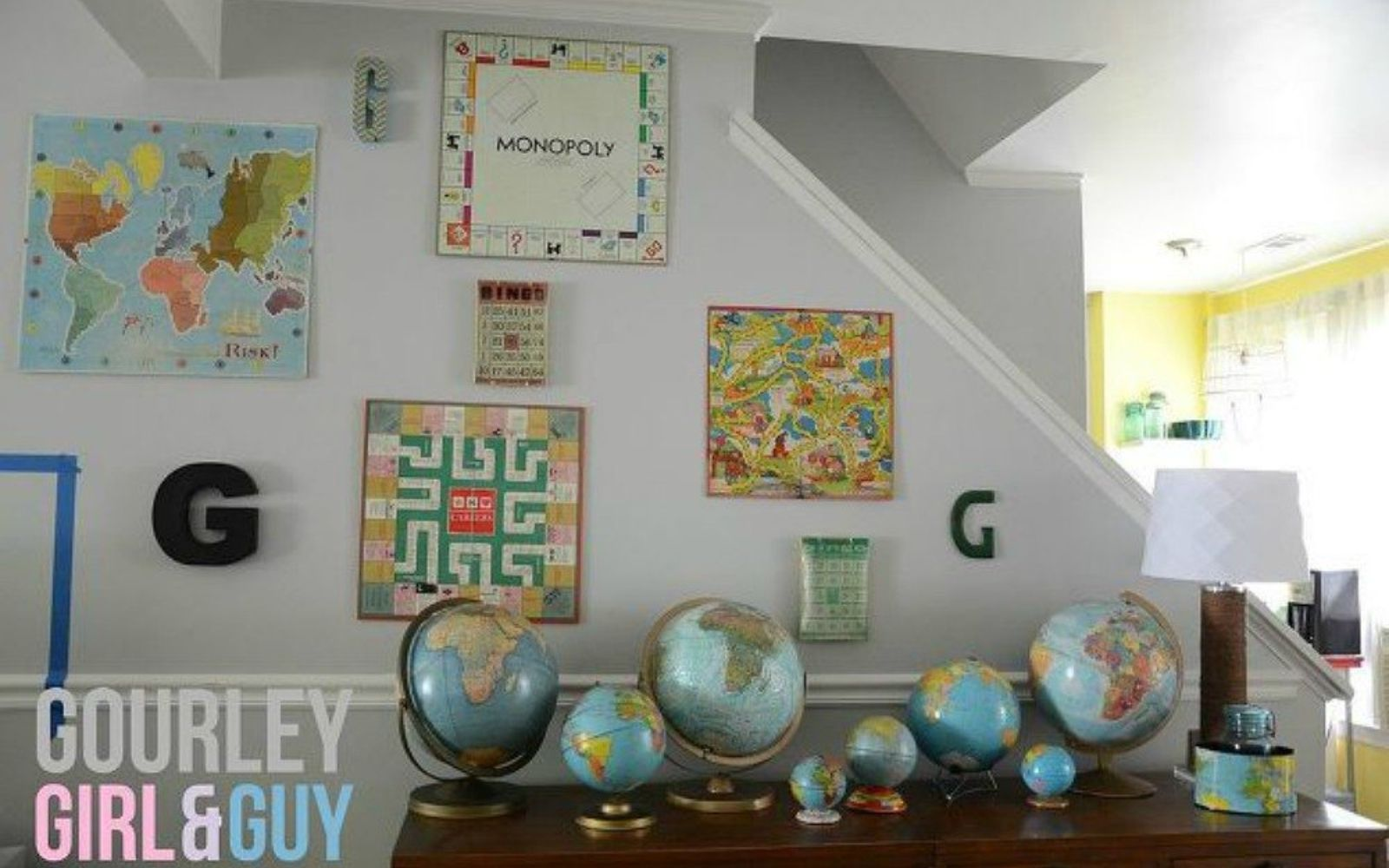 s 13 low budget ways to decorate your living room walls, go green, plumbing, Hang up your favorite board games