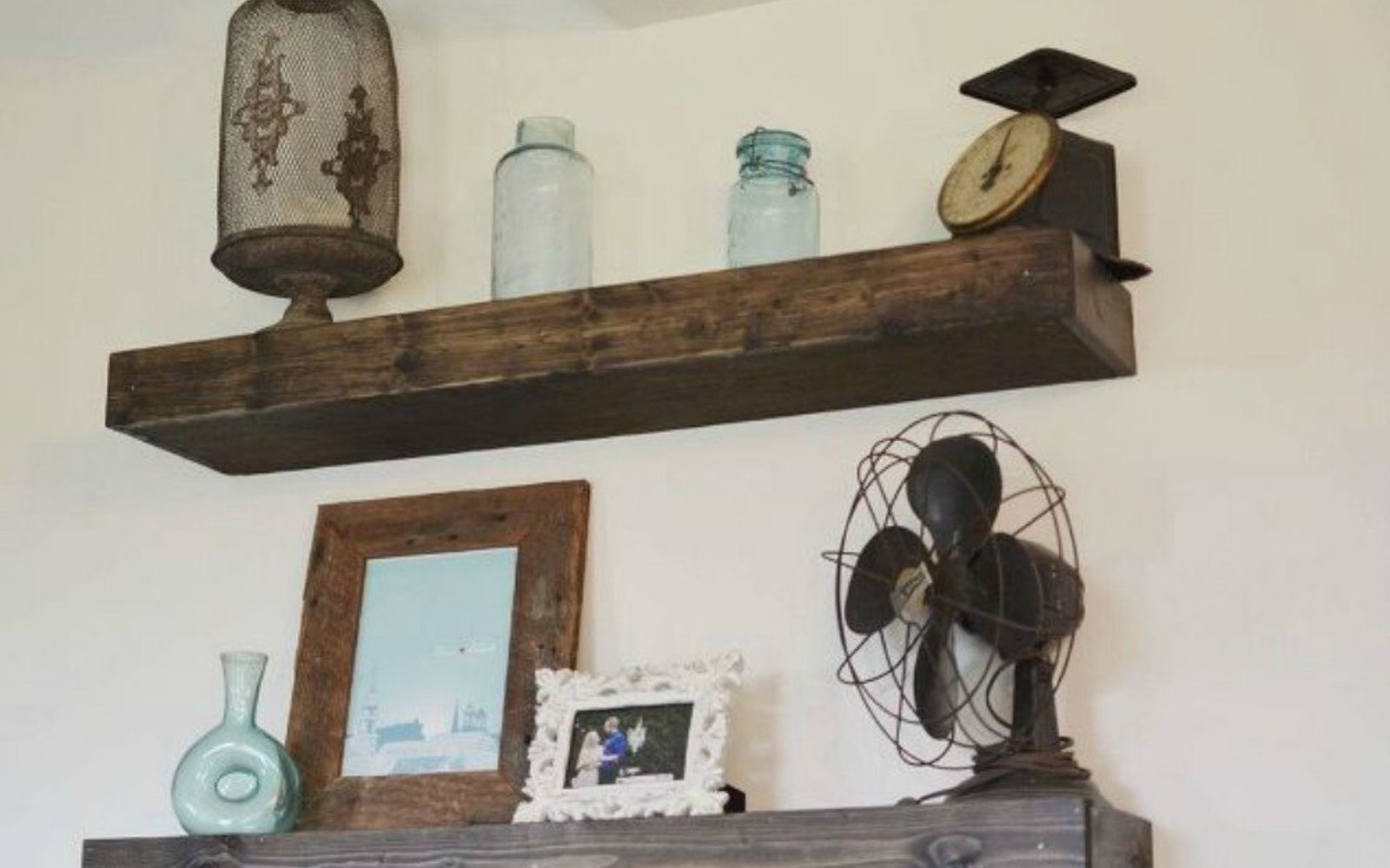 s 13 low budget ways to decorate your living room walls, go green, plumbing, Install some wood floating shelves