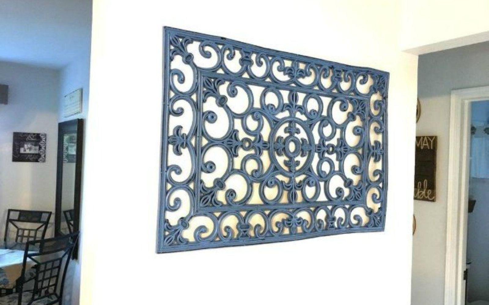 s 13 low budget ways to decorate your living room walls, go green, plumbing, Hang a rubber door mat