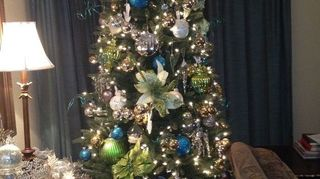 , Seven foot tree increased to eight feet by placing on top of cabinet No tree skirt needed