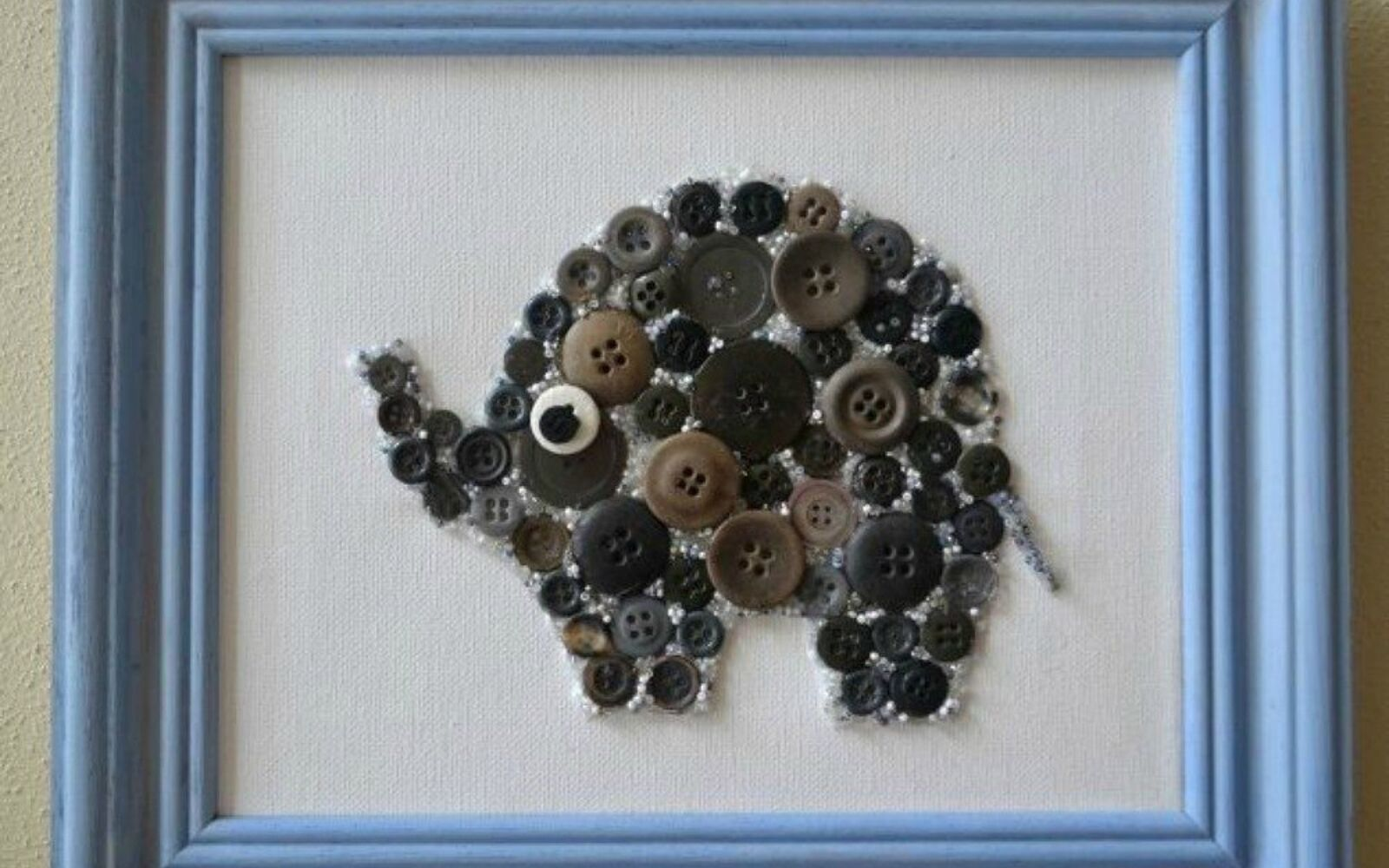 s 15 quick and easy gift ideas using buttons, Turn them into an adorable framed elephant