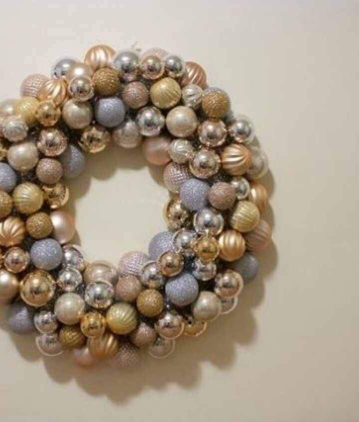 s raise your home s curb appeal with these 15 ornament wreaths, christmas decorations, crafts, curb appeal, home decor, seasonal holiday decor, wreaths, This gold one that has silver garland