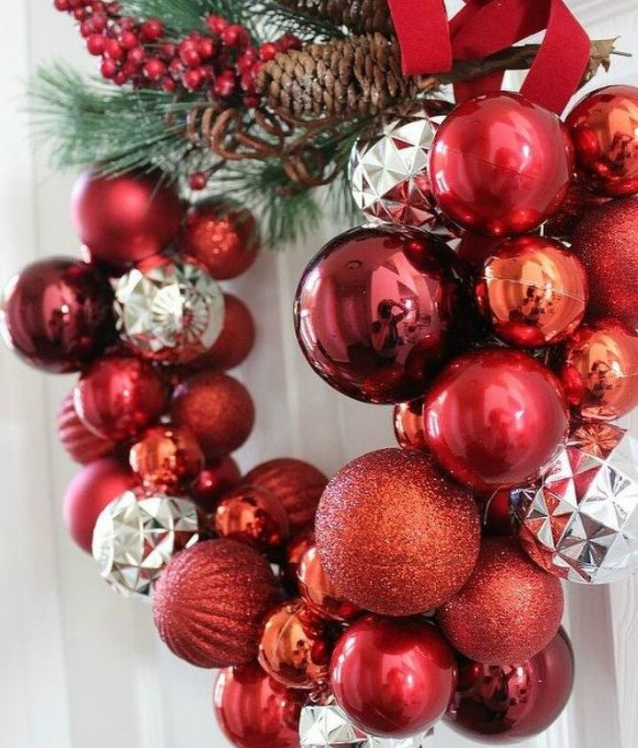 s raise your home s curb appeal with these 15 ornament wreaths, christmas decorations, crafts, curb appeal, home decor, seasonal holiday decor, wreaths, This fun one made out of a clothes hanger