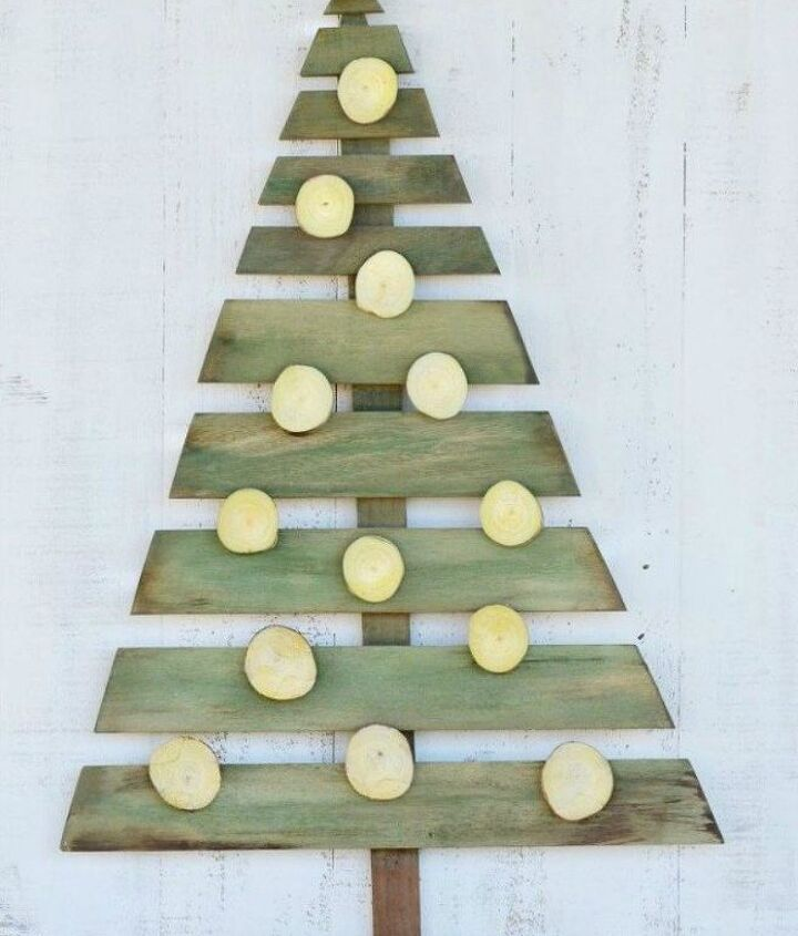 s forget your traditional christmas tree these are even better, Make your own tree out of pallet wood