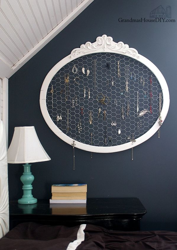 an old frame and chicken wire upcycled into a jewelry hanger