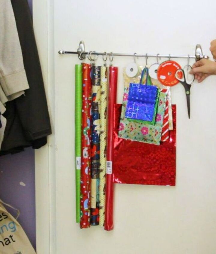 s 14 brilliant command hook hacks for your home, home decor, Keep your wrapping paper wrinkle free