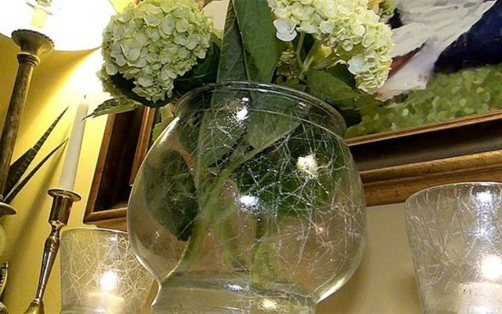 s transform cheap glass vases with these 17 stunning ideas, Draw with a crayon for a crackled glass look