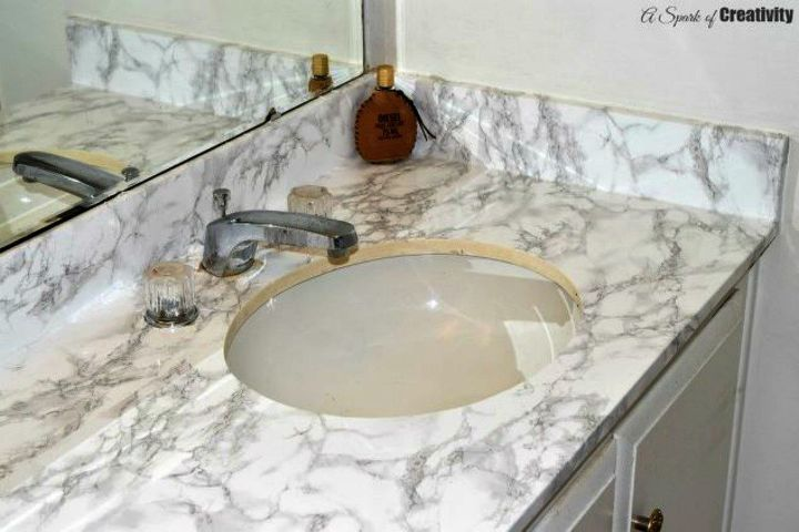 s how to get a gorgeous bathroom in less than three hours, bathroom ideas, how to, Apply marble contact paper to your vanity top