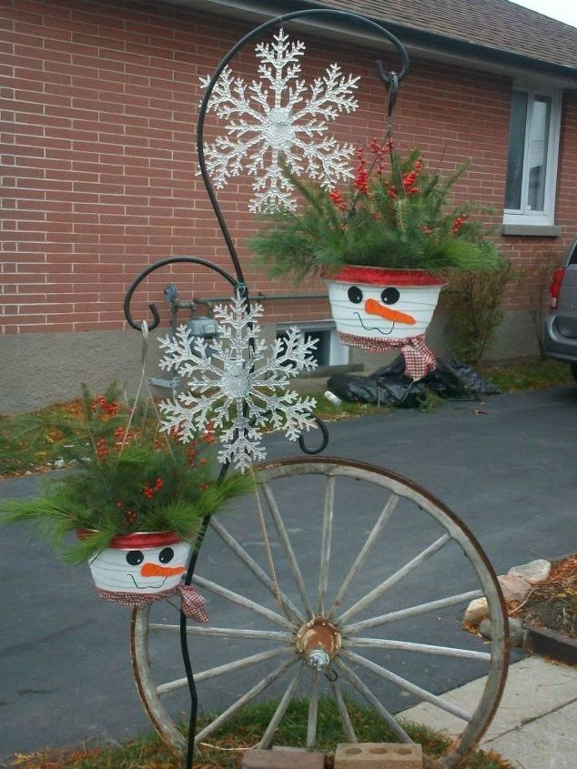 s 13 winter planter ideas for when you re missing your garden, gardening, A snowman themed hanging planter with holly