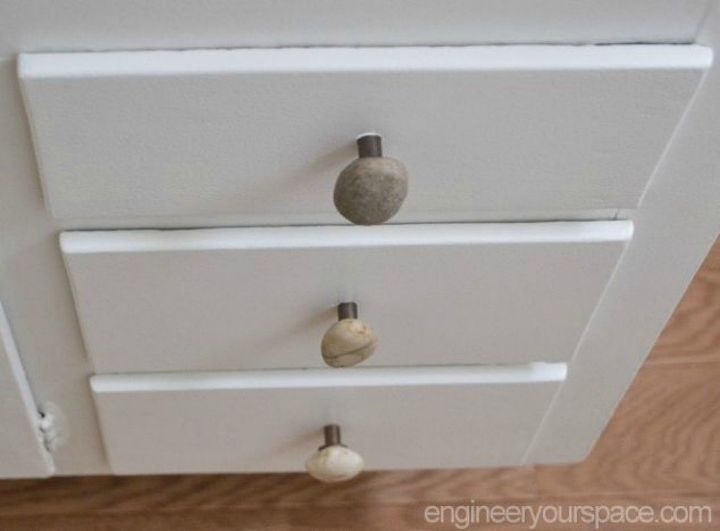 s upgrade your boring cabinets with these 11 knob ideas, kitchen cabinets, kitchen design, Add a touch of rustic to them with stones