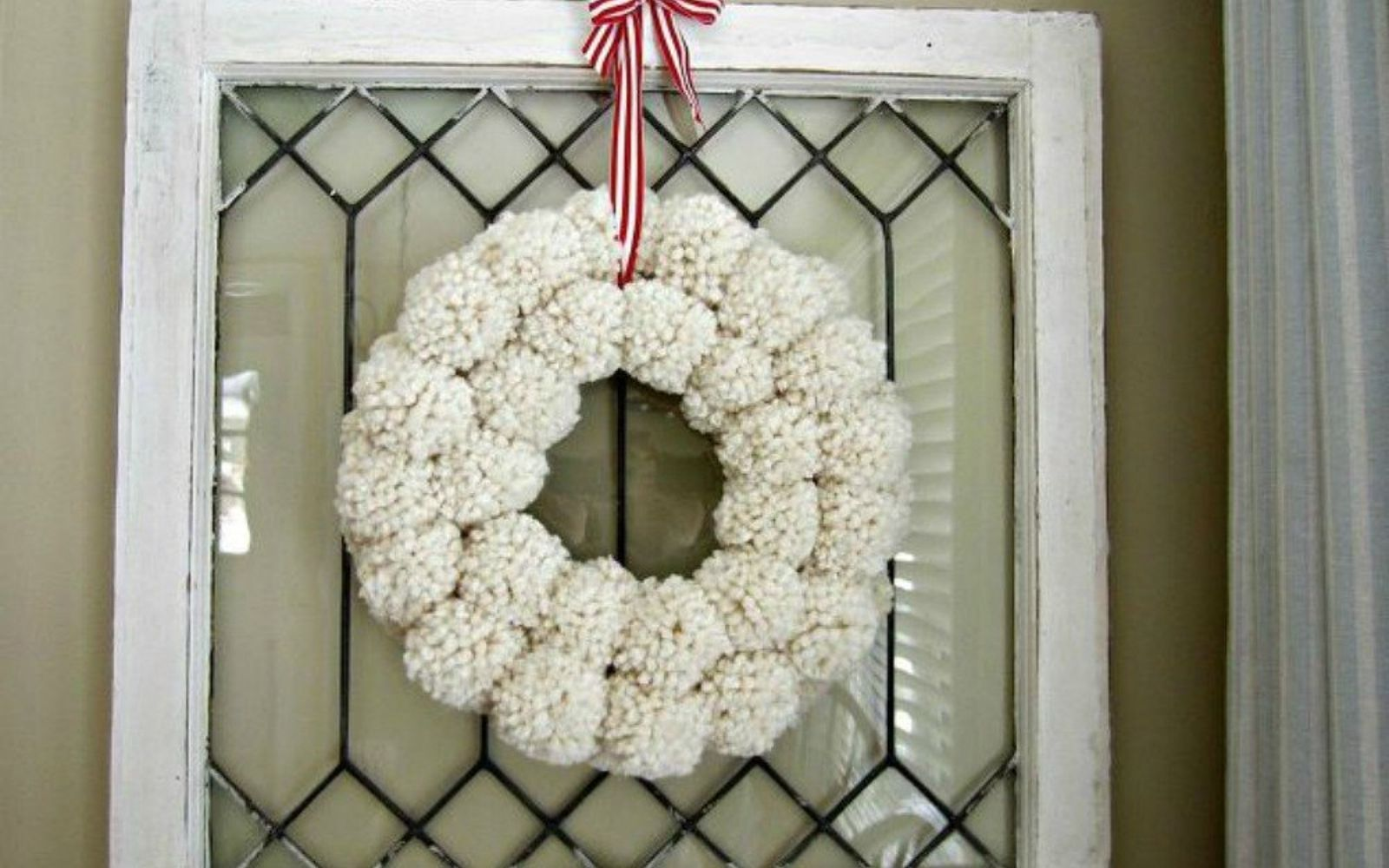s 16 affordable ways to warm up your home this winter, home decor, Make an Anthro inspired pom pom wreath