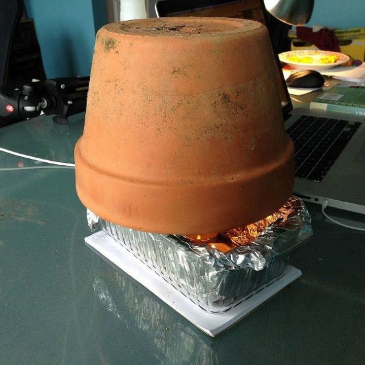 s 16 affordable ways to warm up your home this winter, home decor, Make your own space heater with a terra cotta