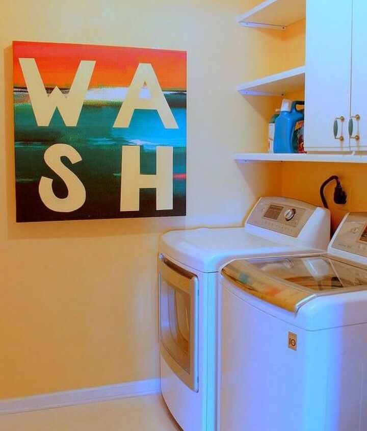 s hate your dreary laundry room try these 13 cute ideas, laundry rooms, Create a collapsible folding table with art