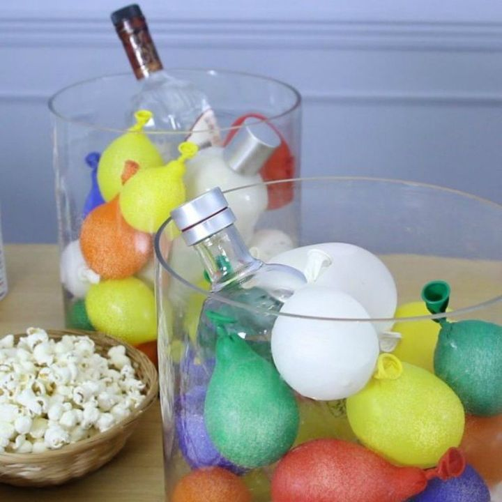 s be the best hostess on the block with these 16 home hacks, home decor, Use water balloons to keep your drinks cold