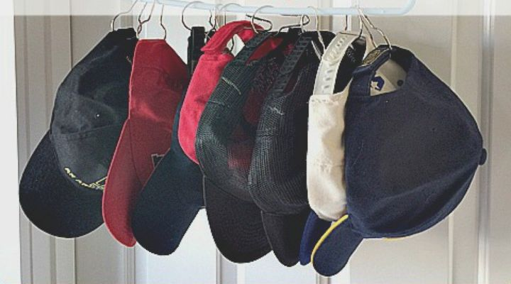 s 12 sneaky ways to fake a type a bedroom even if you re type b, bedroom ideas, organizing, Organize your hats with shower hooks